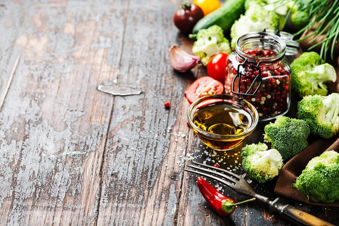Fresh green broccoli and Healthy Organic Vegetables on a Wooden Background