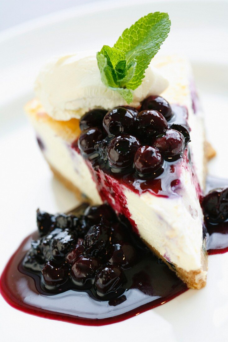 A piece of cheesecake with blackcurrants