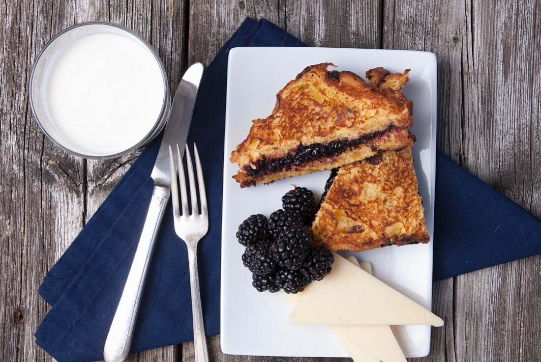 French Toast with blackberries, cheese and milk