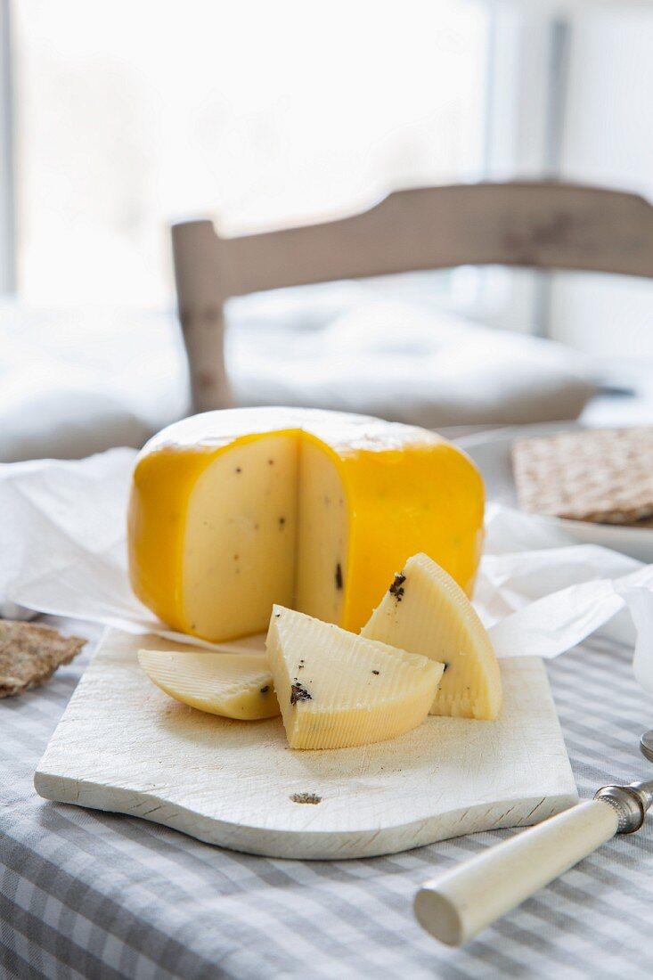 Truffle gouda on a cutting board