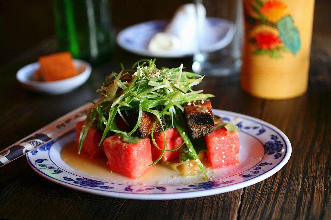 Watermelon pickle and crispy pork salad (pork belly, fresh herbs, sweet ginger)