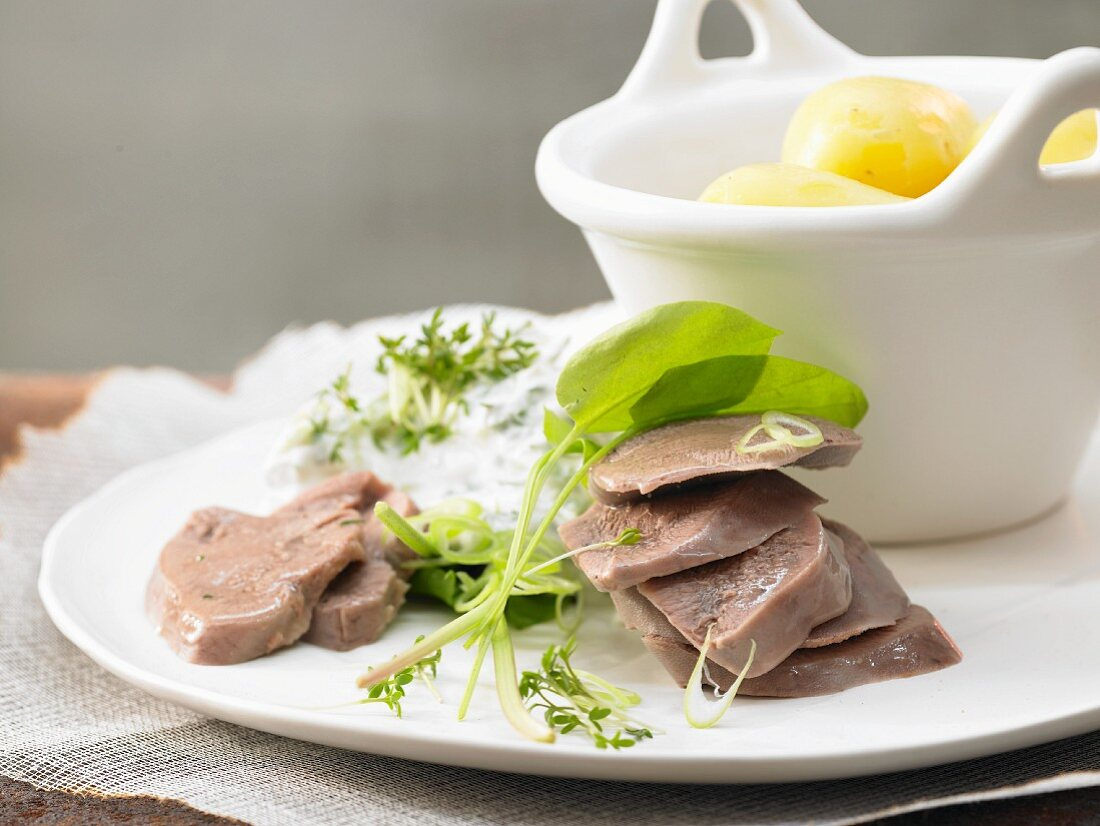 Boiled veal tongue with quark and potatoes