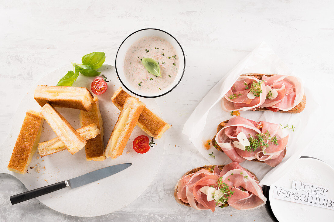 Pamboli (Mallorcan bread) with a dip and crostini topped with prosciutto