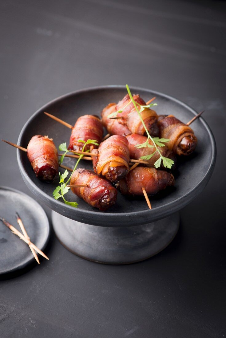 Dates wrapped in bacon