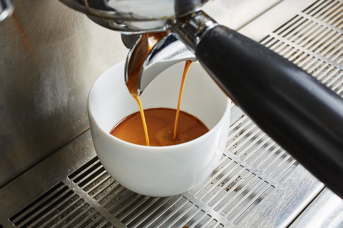 Coffee pouring from a coffee machine