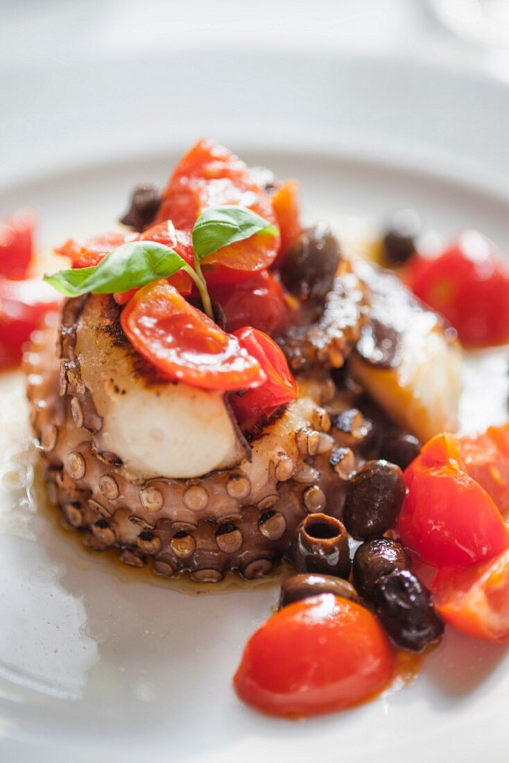 Fried octopus with cherry tomatoes and stoned olives