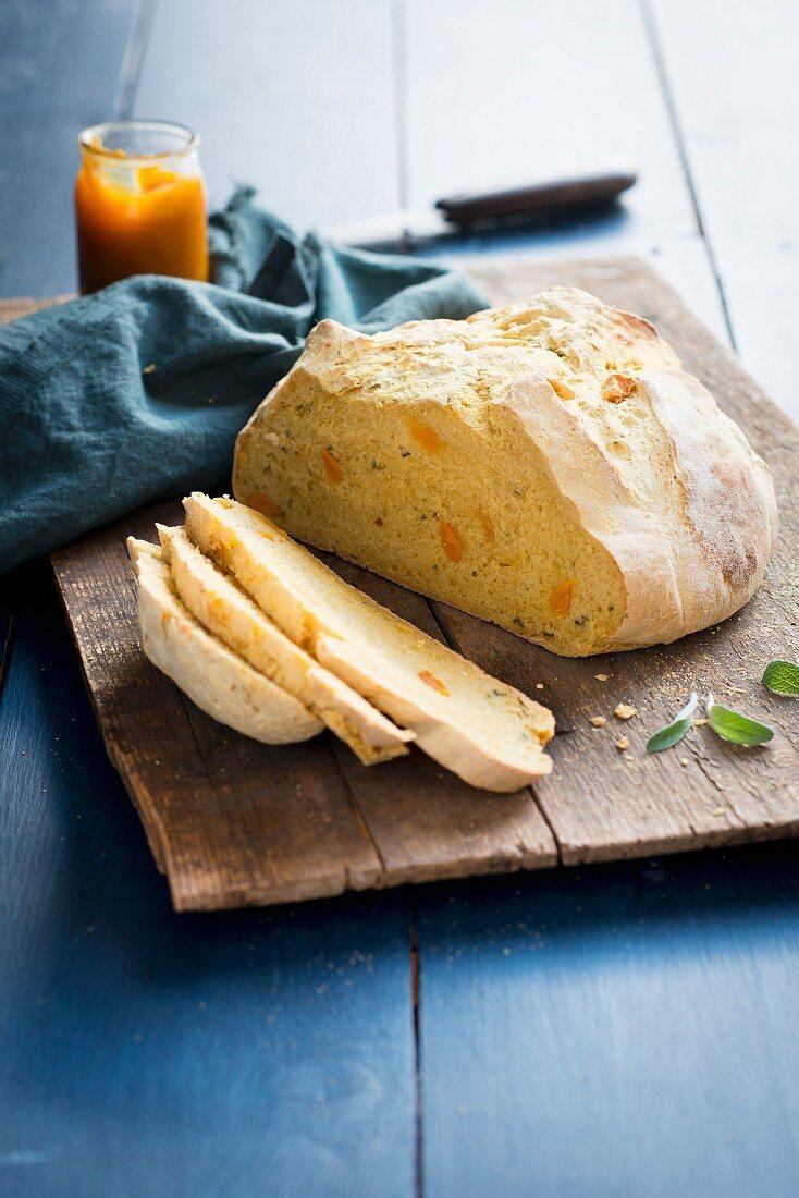 Sliced pumpkin bread on a wooden chopping board