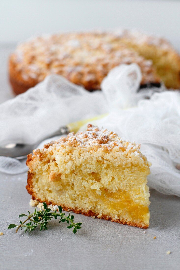 A slice of Lemon coffee cake filled with lemon curd