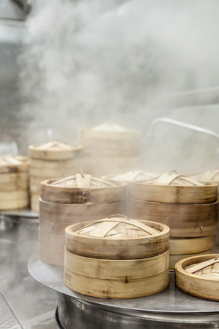 Bamboo steaming baskets in a steamy kitchen in China