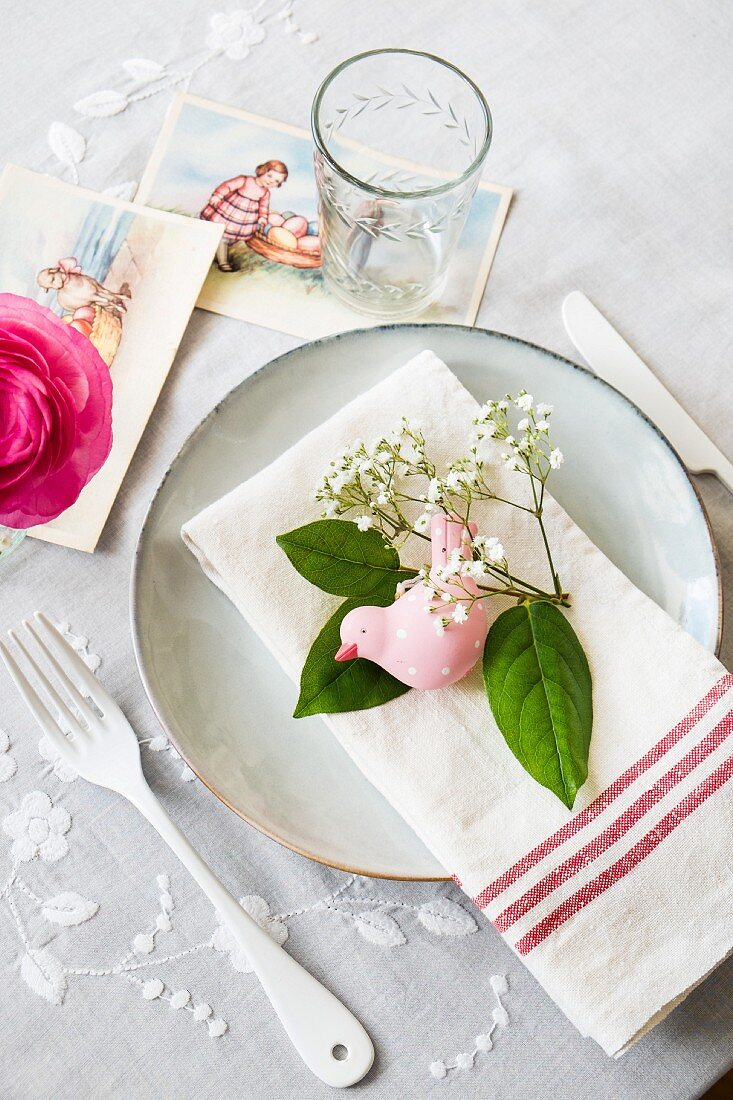 Easter decorations with a bird figurine and baby's breath