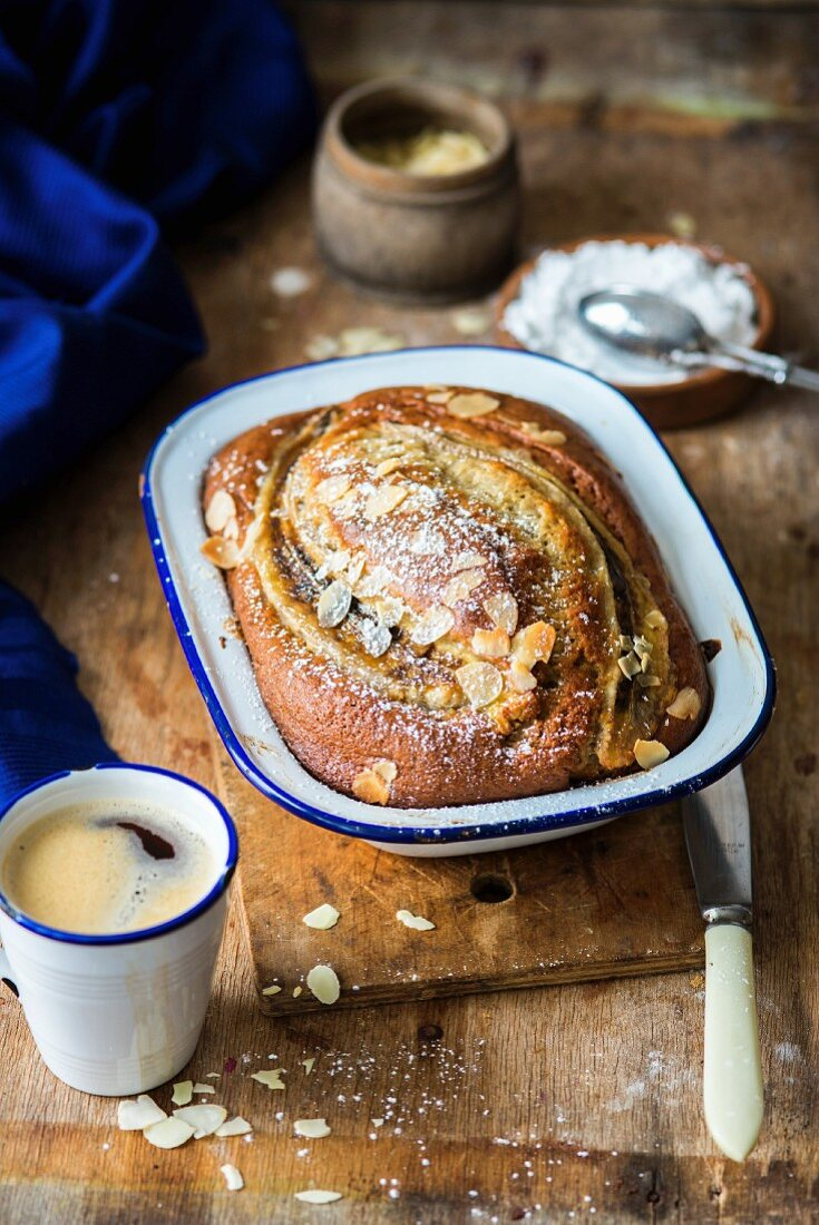 Banana bread with flaked almonds and icing sugar