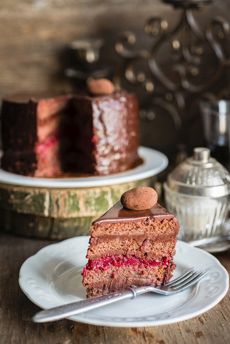 A chocolate truffle cake with cherry jam filling