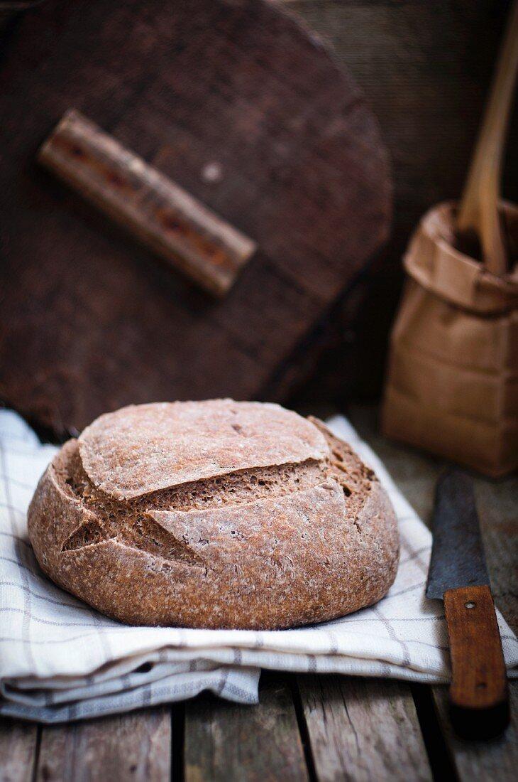 Homemade bread on a tea towel