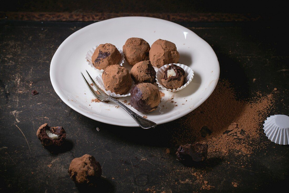 Homemade chocolate truffles with marzipan and cocoa powder
