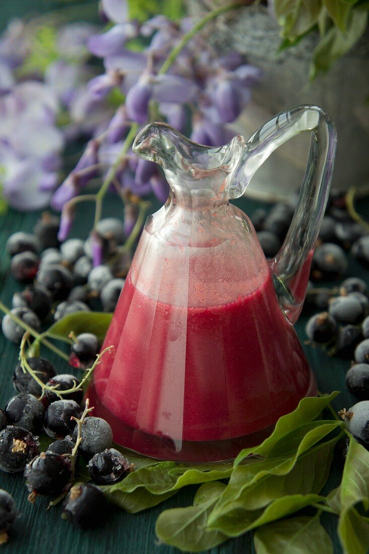 Homemade currant and egg liqueur in a glass caraffe