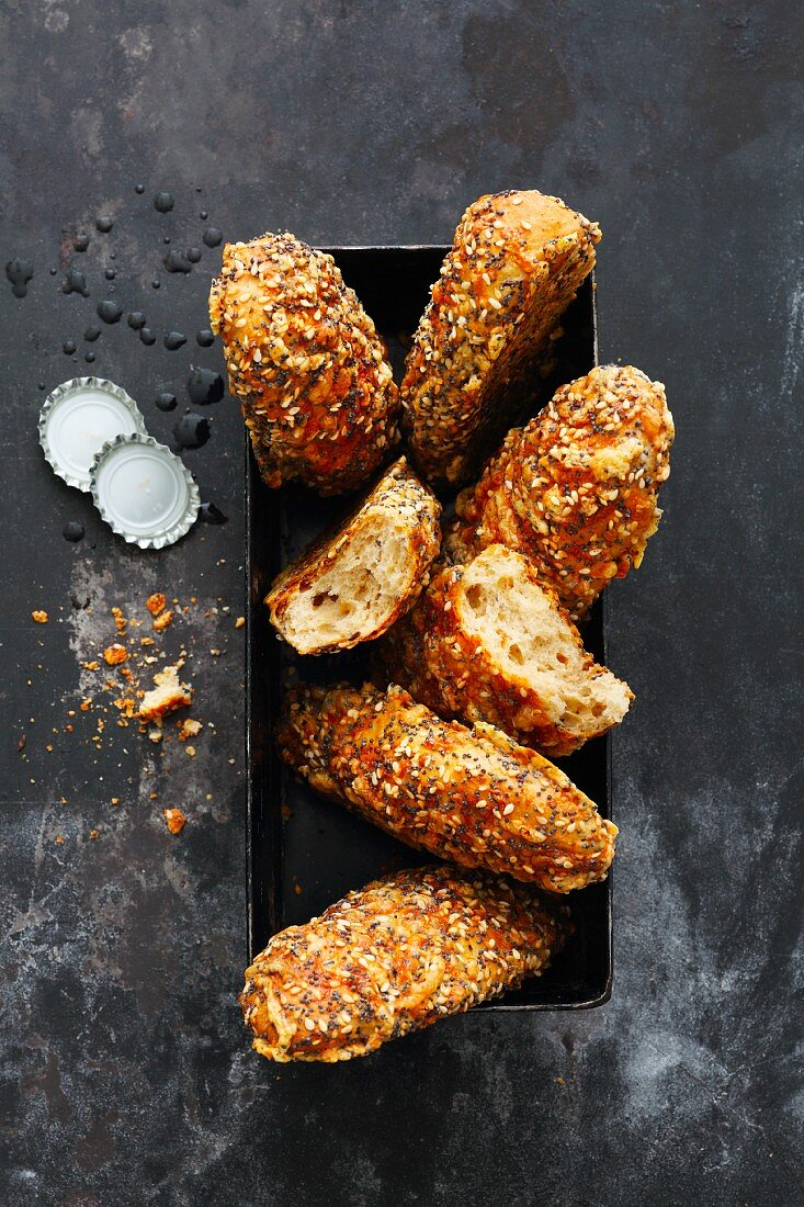Savoury crusty rolls with cheese, pepper and seeds to enjoy with beer
