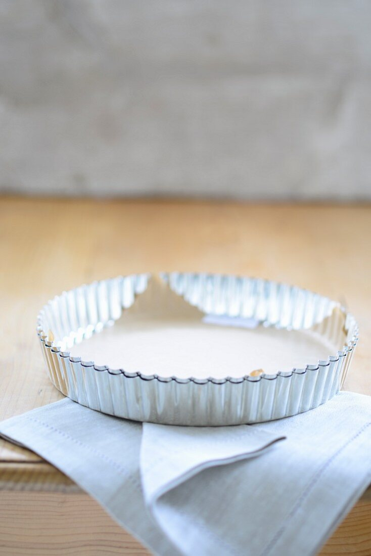 A baking tin with baking paper