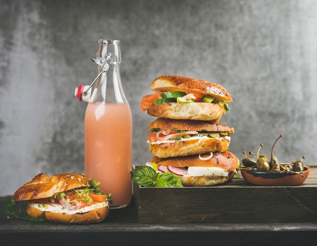 Bagels with salmon, eggs, vegetables, capers and cream-cheese and bottle of grapefruit lemonade