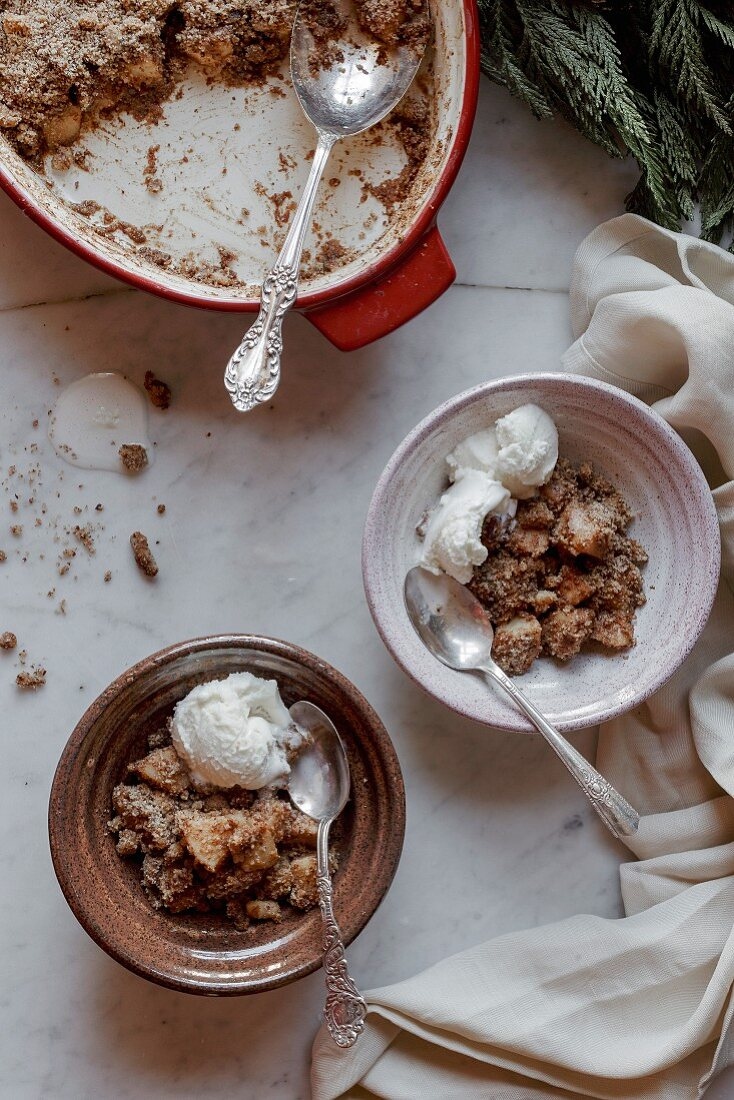 Fruit cobbler and ice cream in bowls