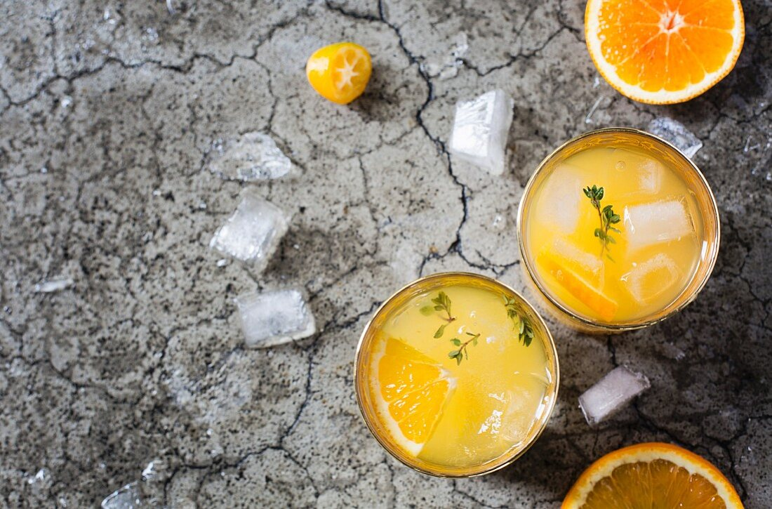 Cocktail with orange juice on grey background