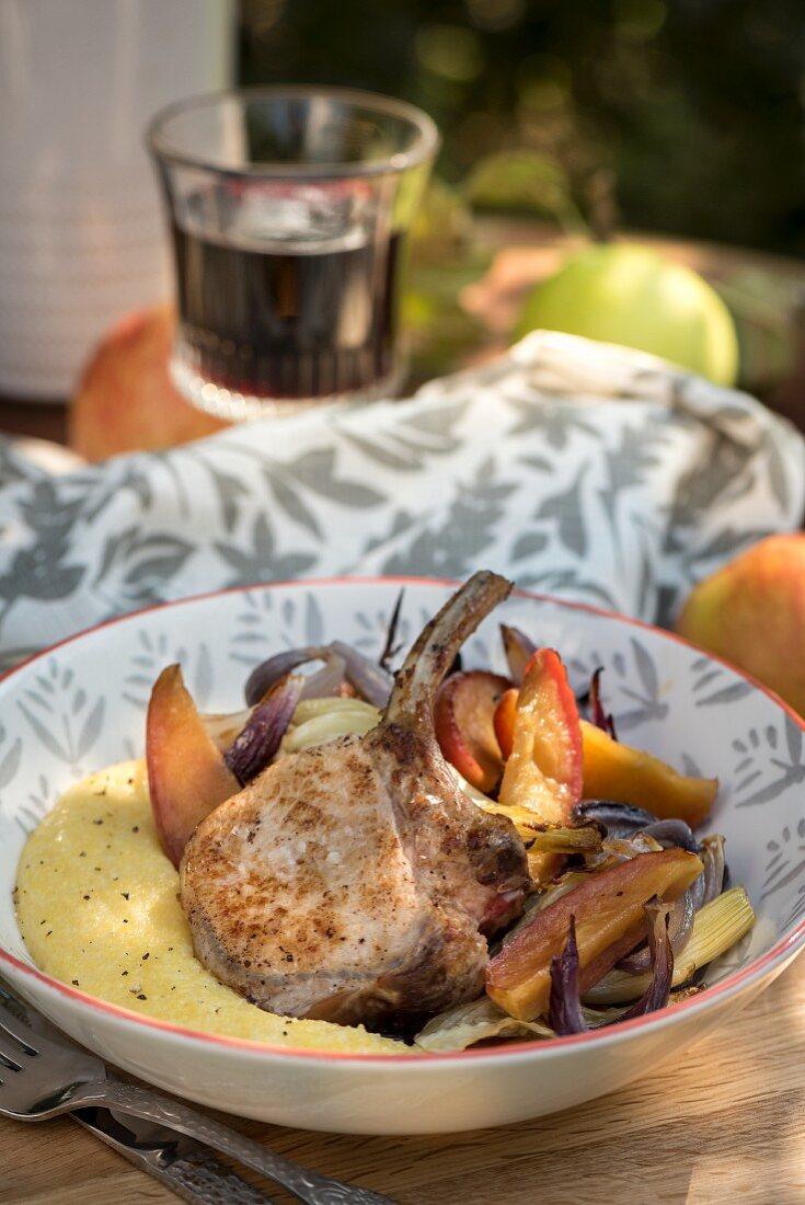 A pork chop with apple, fennel and polenta