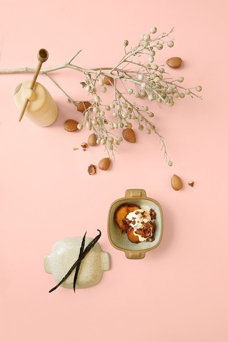 Baked peaches with honey, almonds and creme fraiche