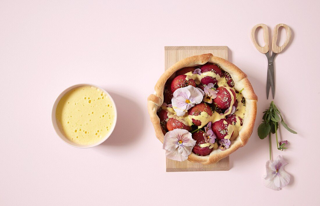 Plum pies with zabaione and pansies