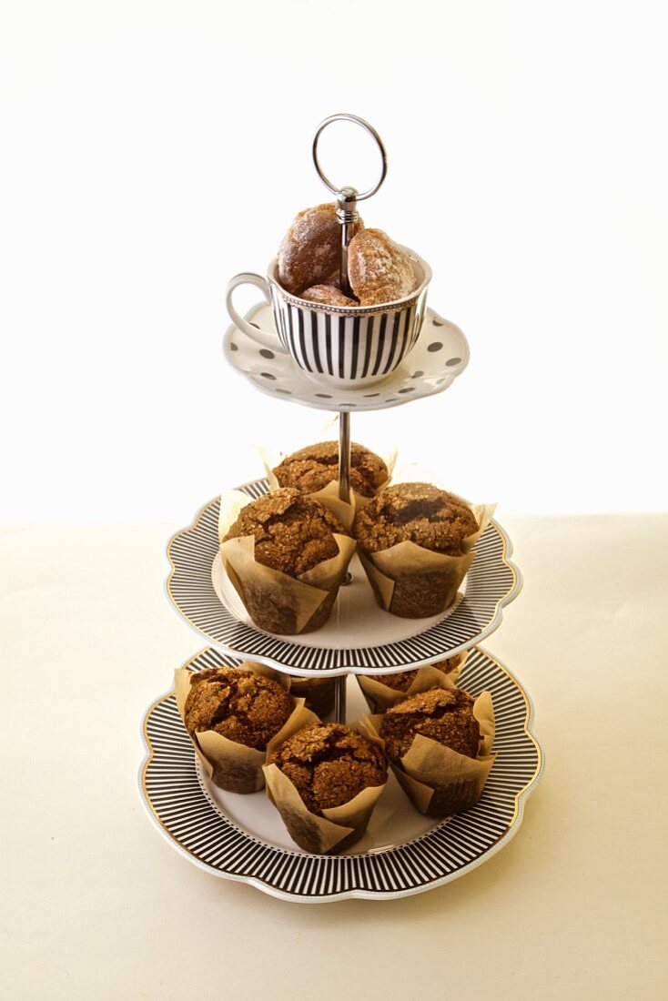 Chocolate muffin and coconut cookies on a tea tiered tray
