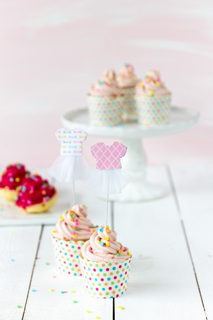 Colourful cupcakes with tutu decorations