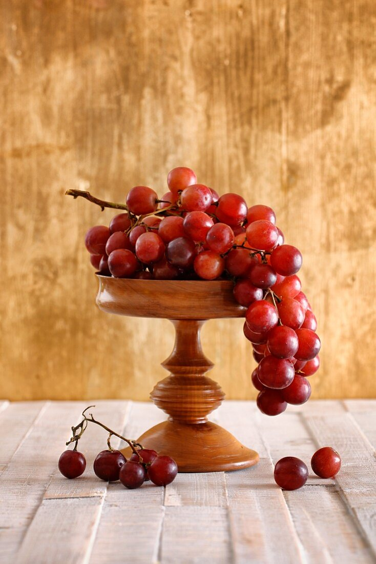 Red grapes on a wooden stand