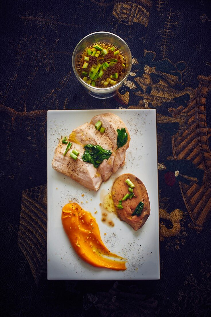 Chicken breast with foie gras, vegetable puree and broth in a glass