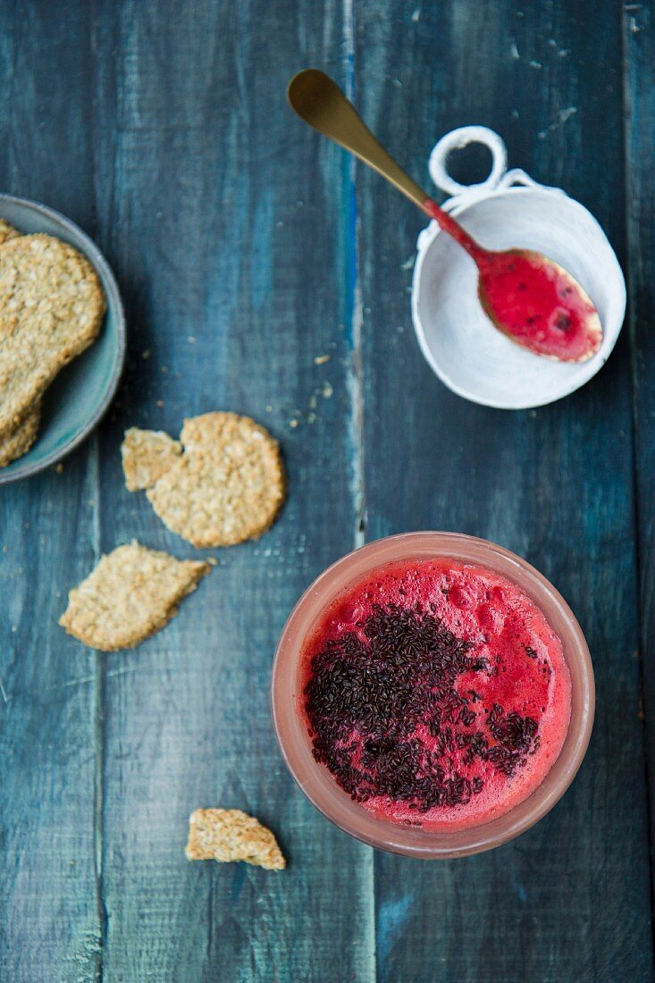 A beetroot smoothie with carrots, pineapple and chia seeds, with oat biscuits