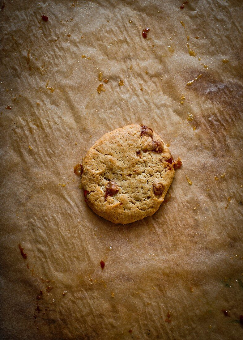 A caramel cookie on baking paper