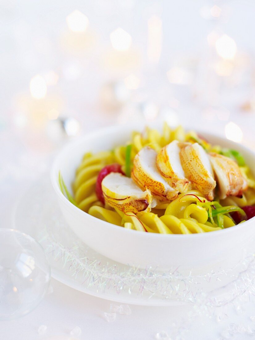 Crab tails in saffron and leek sauce with fusilli pasta and roasted tomatoes (Christmas)