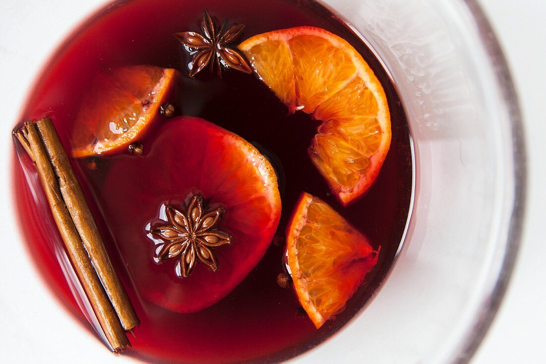 Mulled red wine with spices and fruit in a glass