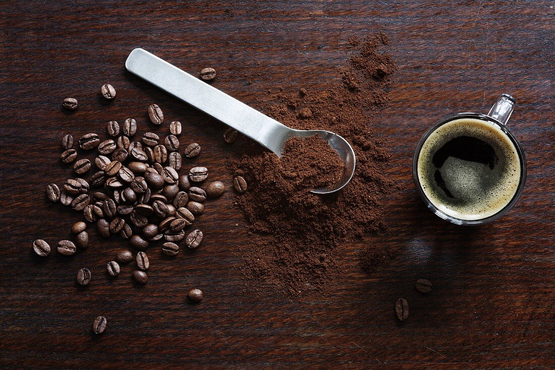 Coffee beans, ground coffee and an espresso