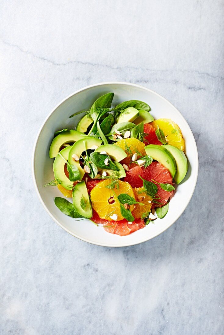 Citrus and avocado salad with baby spinach and almonds
