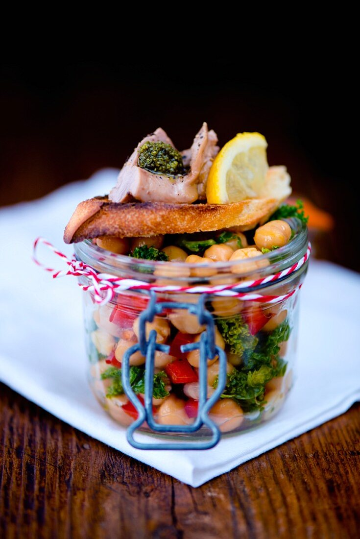 Lunch in a glass jar: chickpea salad and crostini with smoked cod liver, pesto and lemon