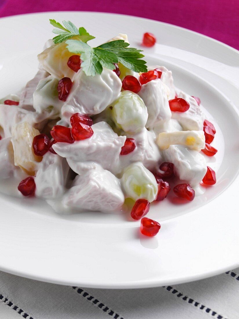 A plate of chicken fruit salad