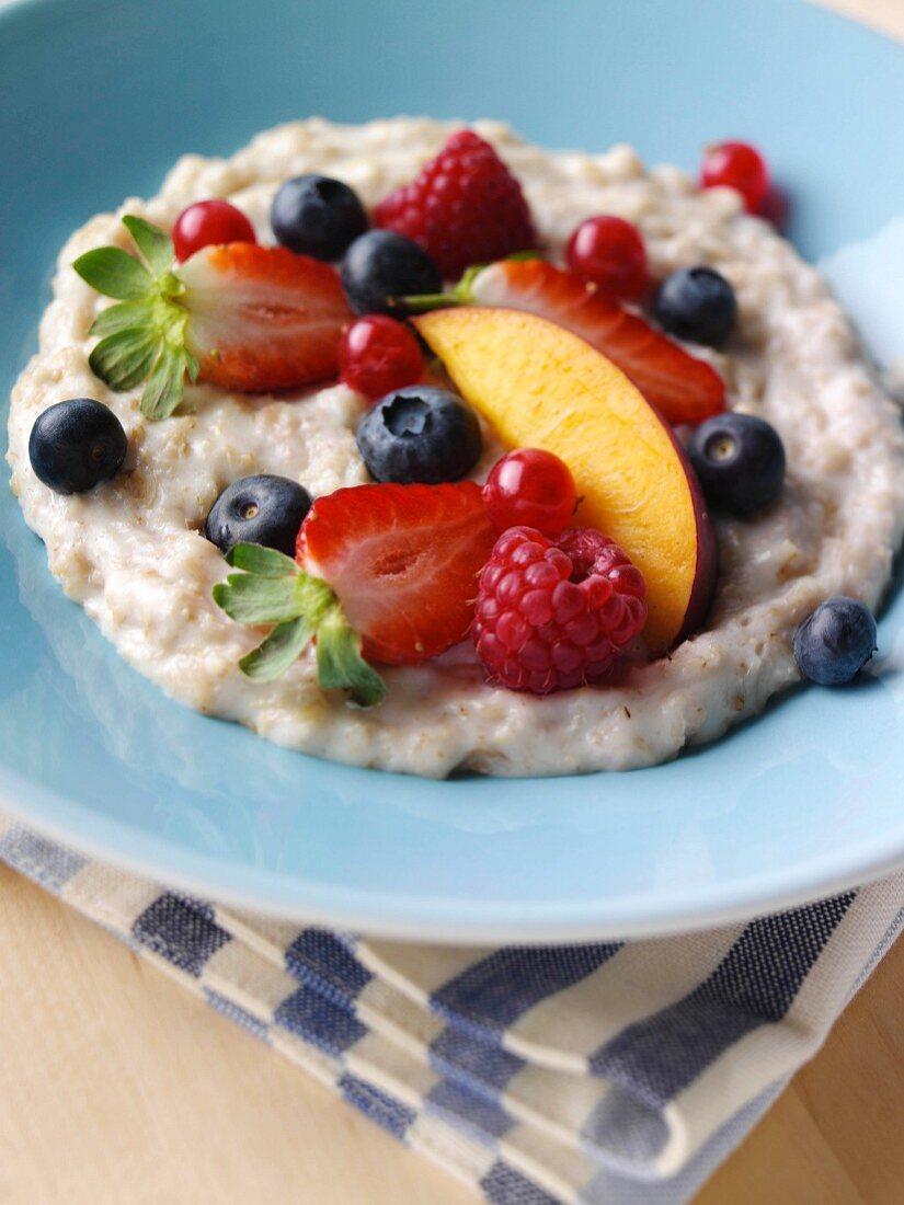 A bowl of porridge and fruit