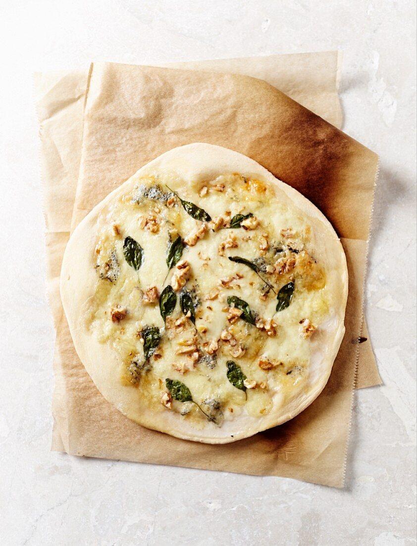 A thin-crust pizza bianca with gorgonzola, mozzarella and walnuts
