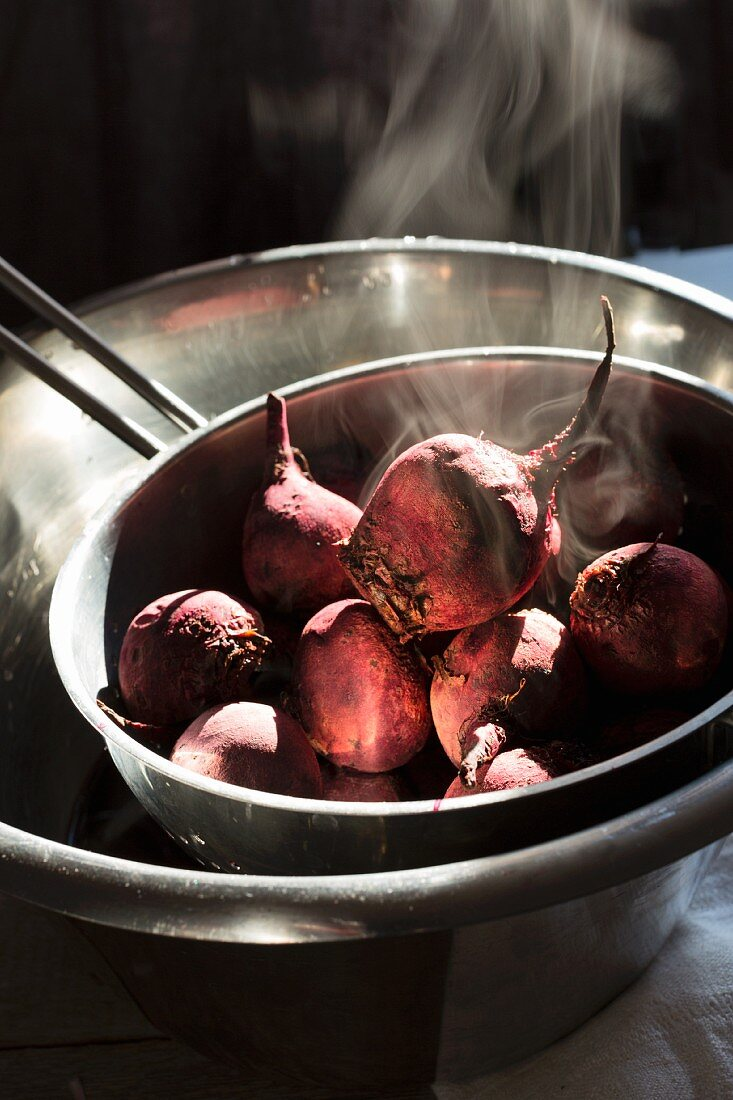 Freshly cooked beetroot cooling in a metal sieve