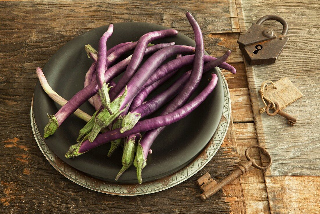 Long, thin aubergines on a plate