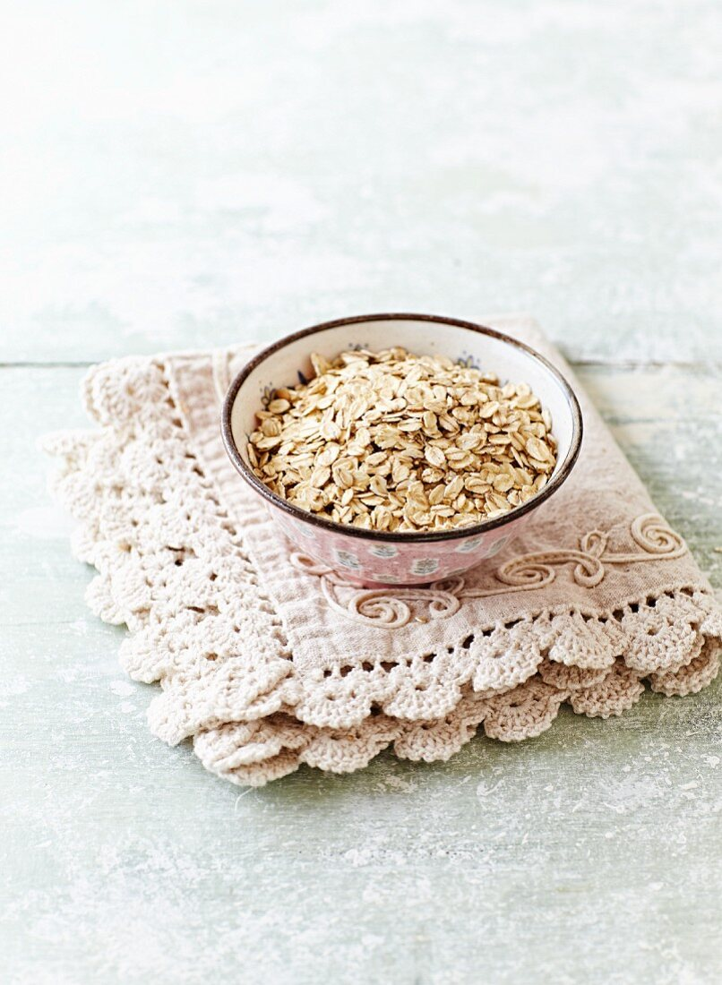 Organic oat flakes in a ceramic bowl