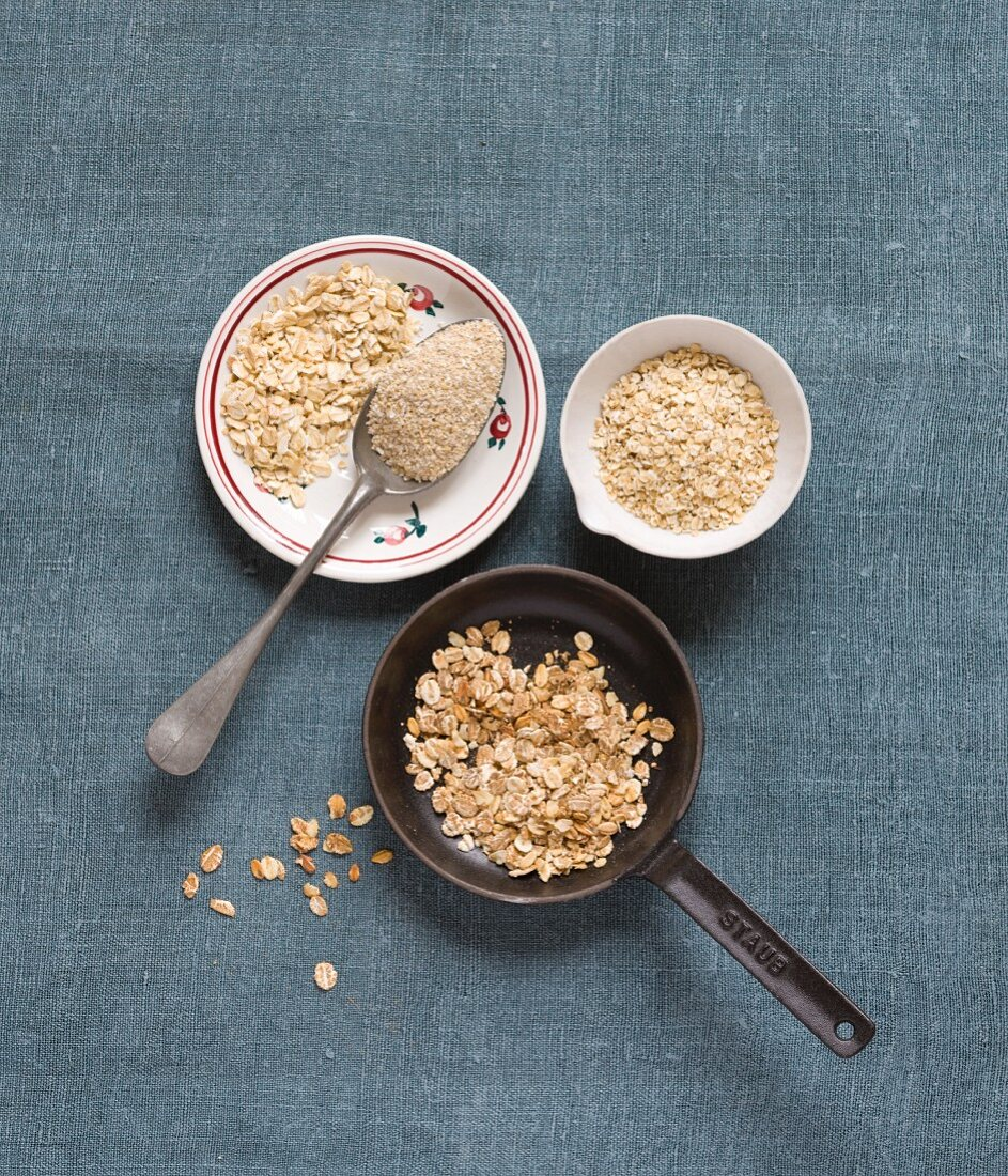 Oats in little bowls and a pan