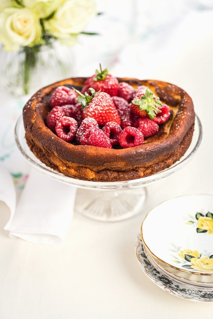 Low fat Quark cheesecake with fresh berries on a cake stand