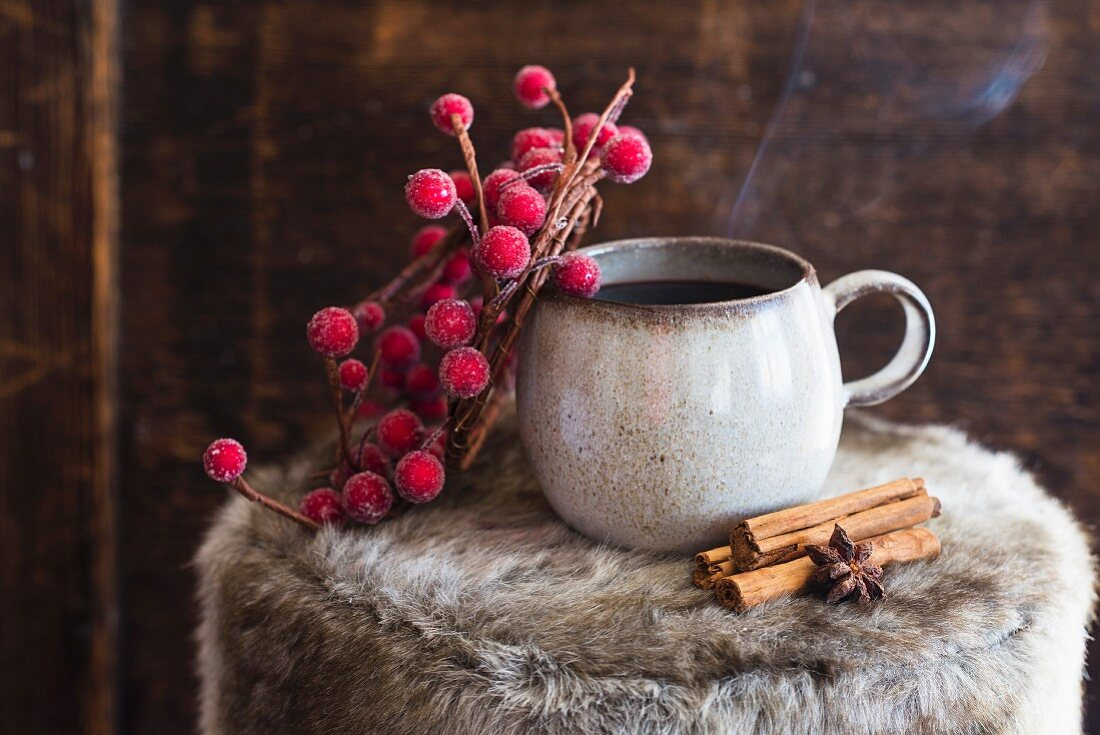 Mulled wine with a twig of berries and Christmas spices