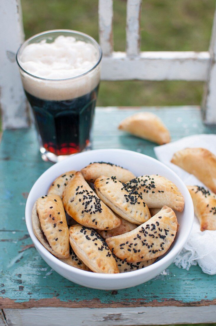 Baked dumplings (pierogi) stuffed with black pudding and topped with black caraway seeds. Served with glass of dark beer