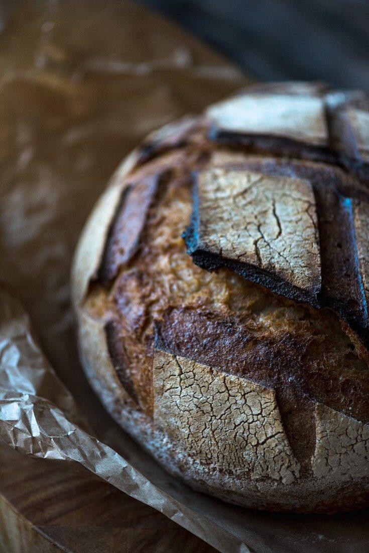A loaf of dark sourdough bread