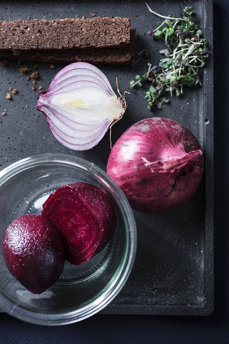 Ingredients for beetroot and apple soup with onions, cress and pumpernickel bread
